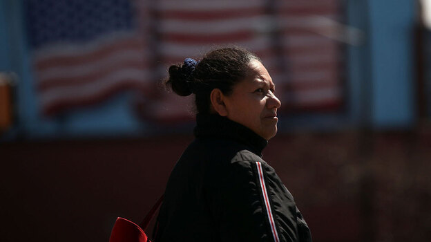 A Hispanic woman walks down a street in Union City, N.J. In a new study, the Pew Hispanic Center asked Hispanic-Americans how they identify themselves.  (Getty Images)