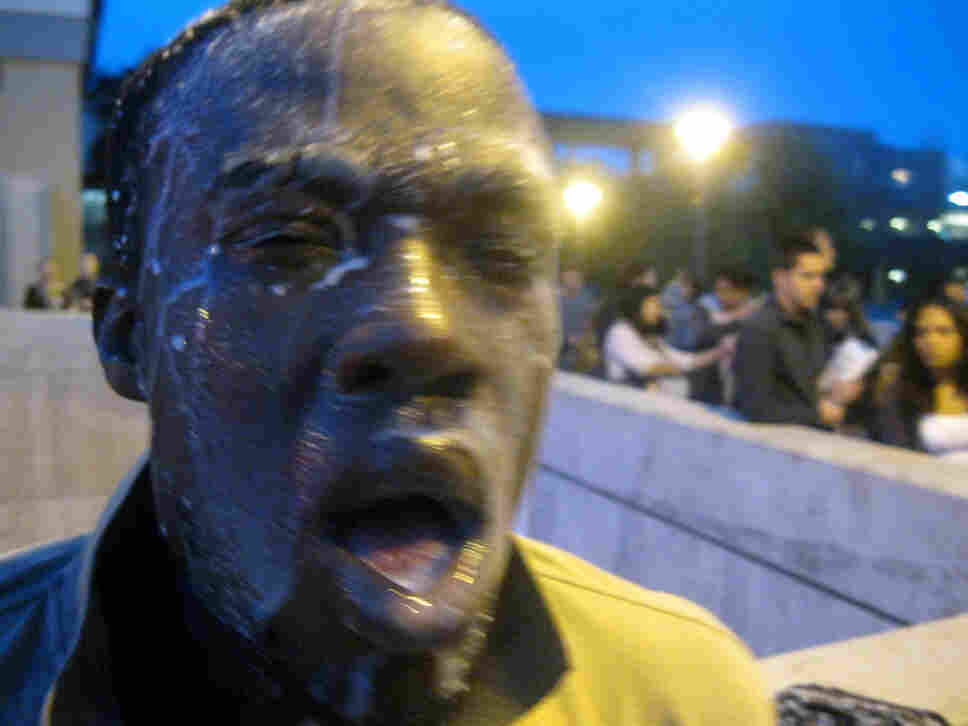 Nnaemeka Alozie, campaign manager for California congressional candidate David Steinman, poured milk on his face Tuesday after being pepper sprayed during the incident at Santa Monica College.