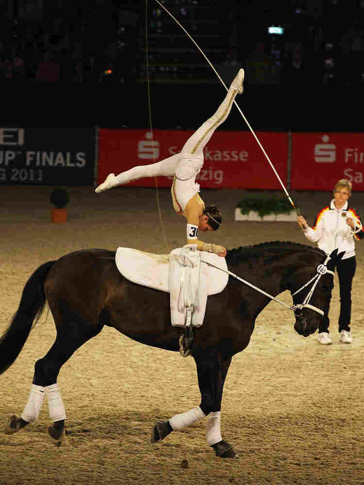 "Simone Wiegele of Germany riding ""Arkansas"" in action during a 2011 competition in Leipzig, Germany. The sport is becoming more popular in the American northwest, and parents of kids who learn horse vaulting say it helps teach concentration and confidence."