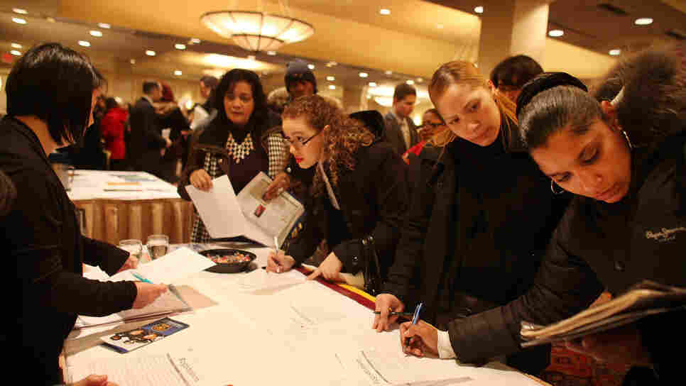 Job seekers attend a career fair in New York City. Federal Reserve Chairman Ben Bernanke says the quick drop in unemployment might have been a reversal of overzealous cutbacks during the financial crisis.