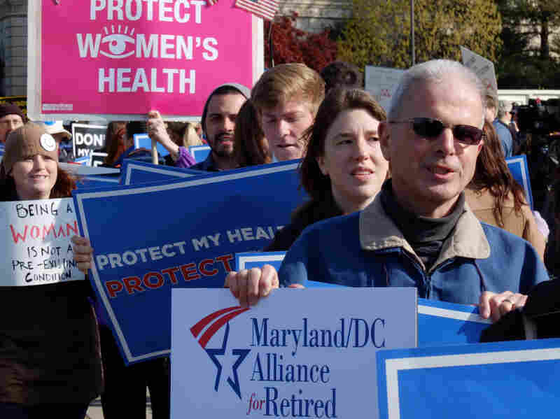 Obamacare supporters shout slogans outside the Supreme Court on the third day of oral arguements over the constitutionality of the Patient Protection and Affordable Care Act on March 28, 2012 in Washington, DC.