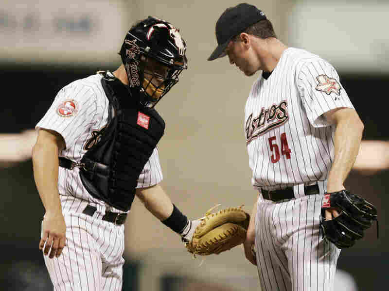 Ausmus (left), playing for the Houston Astros in 2006, talks with pitcher Brad Lidge on the mound during a game.