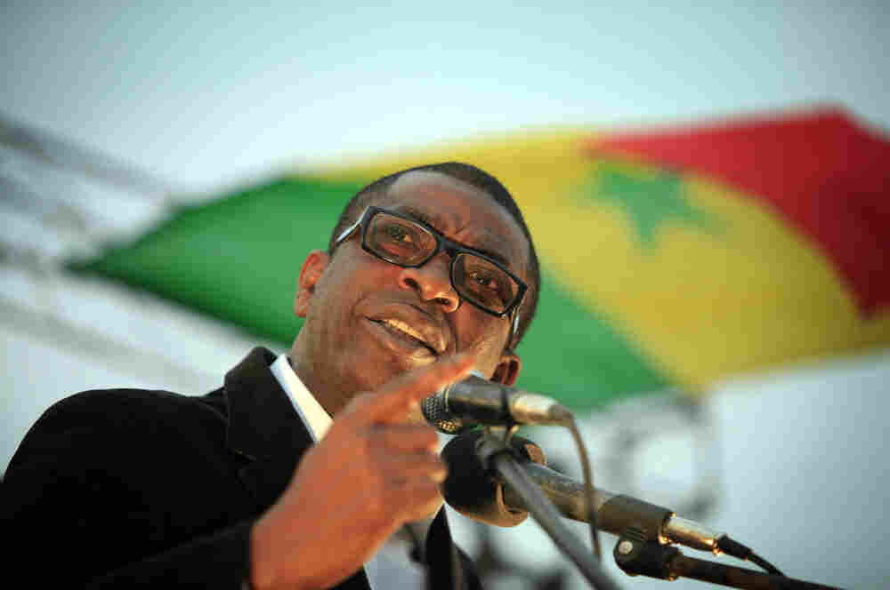 Youssou N'dour speaks during a united opposition rally in February.