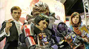 Costume designer Holly Conrad (center) poses with some of her own creations inspired by the popular video game Mass Effect.