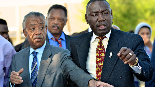 Benjamin Crump (right), the attorney for Trayvon Martin's family, is joined by the Revs. Al Sharpton and Jessie Jackson at a protest in Sanford, Fla., last week. Crump has enlisted the help of prominent civil rights activists to draw attention to the case.  (Getty Images)