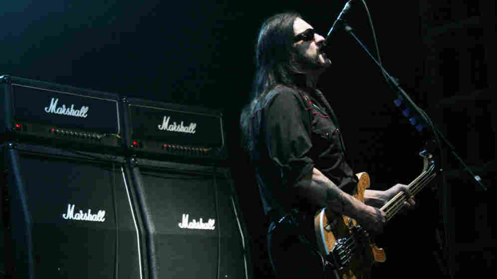 Lemmy Kilmister of Motorhead in front of a line of Marshall amps.