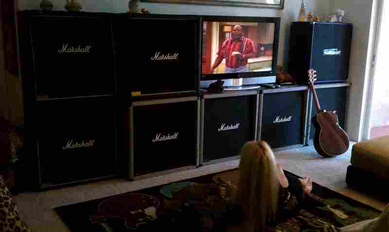 "Former Runaways guitarist and hard rock goddess Lita Ford sent us this picture with her Marshall-stacked home entertainment center. She writes via email: ""[Jim Marshall] can rest easy and go to his grave knowing the profound effect he's had on the face of the WORLD of music that will remain with us forever!!!!! His tombstone should be a Marshall stack. His voice will live on through those speak..."