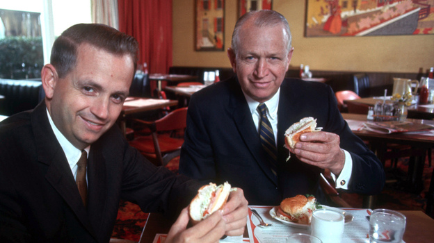 J.W. Marriott dines with his son Bill in a Hot Shoppe in March 1969. The elder Marriott was close to Mitt Romney's father, George.  (Landov)