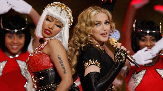 Nicki Minaj (left) and Madonna perform during the halftime show at the Super Bowl in February. In a song from Madonna's new album, MDNA, the two singers each play with traditionally feminine and masculine gender roles.