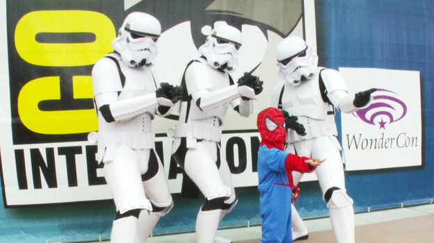 In one of the least unusual cross-universe encounters at San Diego Comic-Con, a little Spider-Man poses with three Star Wars Storm Troopers in Morgan Spurlock's doc