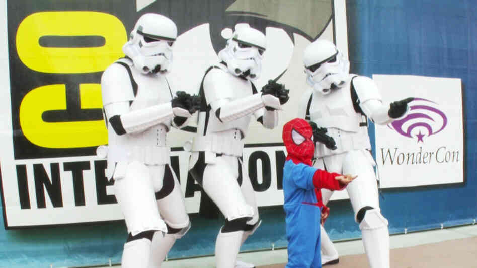 In one of the least unusual cross-universe encounters at San Diego Comic-Con, a little Spider-Man poses with three Star Wars Storm Troopers in Morgan Spurlock's documentary about the annual nerd-gathering.