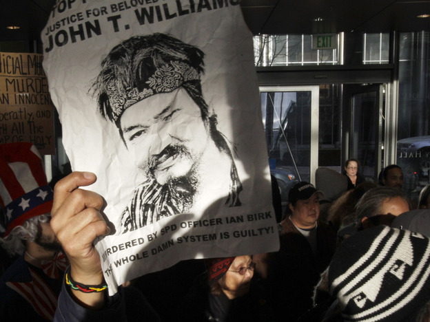 Protesters demonstrate at City Hall in Seattle on Feb. 16, 2011, after the announcement that police officer Ian Birk would not face charges for the fatal shooting of John T. Williams.