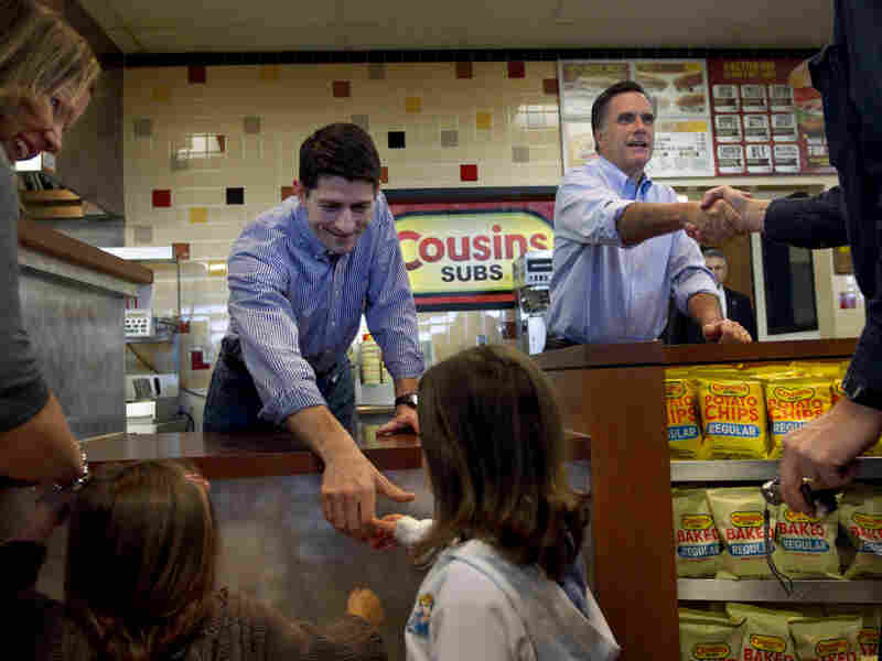 Republican presidential candidate, former Massachusetts Gov. Mitt Romney, accompanied by House Budget Committee Chairman Rep. Paul Ryan, R-Wis, greet people and hand out submarine sandwiches during a campaign stop at a Cousins Subs fast food restaurant in Waukesha, Wis., Tuesday, April 3, 2012. (AP Photo/Steven Senne)