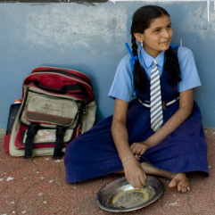 On days she comes to school hungry, K. Suchitra (center) knows she can eat at school.
