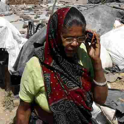 A woman talks on her cellphone in a slum area of Bhopal last month.