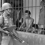 A coup attempt in Indonesia on Sept. 30, 1965, triggered a series of events that led to the ouster of President Sukarno and unleashed a wave of violence against suspected communists in the country that left up to 1 million people dead. In this photo from 1965, Indonesian soldiers watch suspected communists held at Tangerang, a suburb of Jakarta, the Indonesian capital.