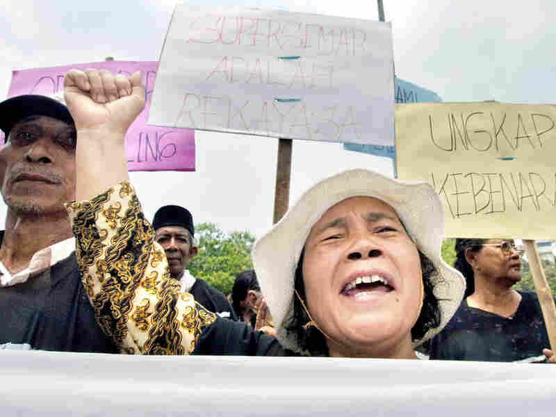 Indonesians protest outside the Presidential Palace in Jakarta, Sept. 28, 2005, calling for the government to bring former dictator Suharto to court for gross human rights abuse related to the deaths of alleged communists and communist sympathizers during the mid-1960s.