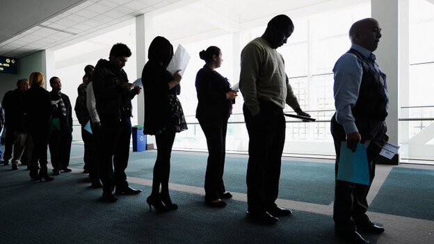 Job seekers line up to enter a career fair in Los Angeles. Both Congress and states are cutting back on unemployment benefits.