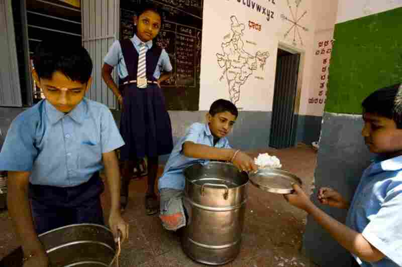 The school lunch program customizes the menu in different parts of the country to local preferences. At this middle school in Bangalore, lunch often consists of a South Indian meal of rice and vegetable-lentil soup.