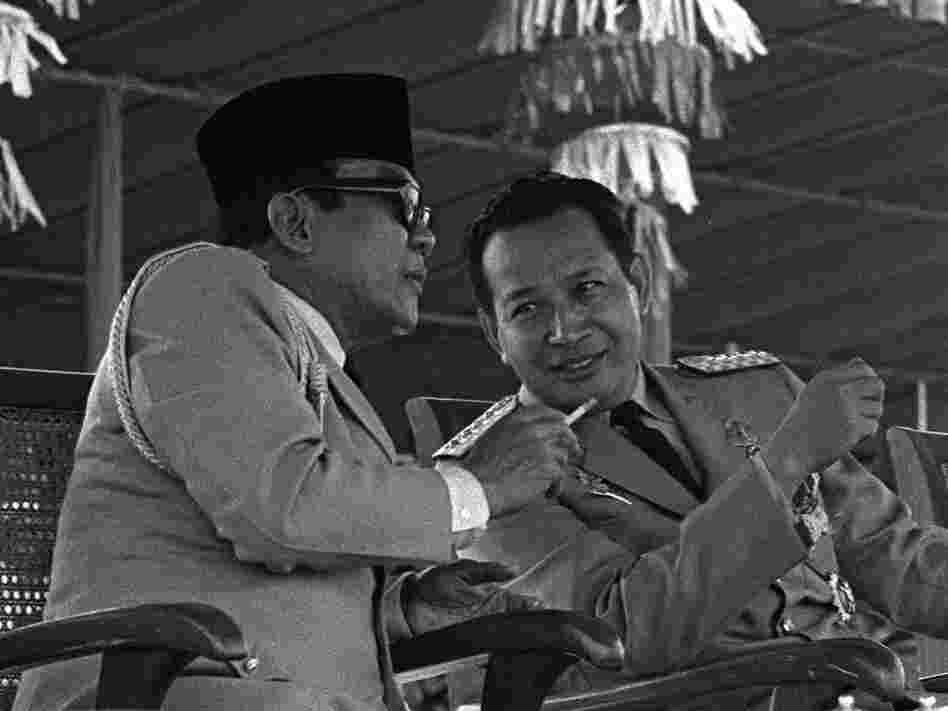 Indonesian President Sukarno (left) surrenders his executive powers to Gen. Suharto, Feb. 22, 1967, in Jakarta. Suharto led the anti-communist purge and ruled the country until 1998.