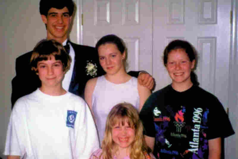 """Caley Burke, 1998: """"In my family, you always take at least one dance picture with your sisters (and whatever random neighborhood kid was also in the house). I'm the one in the dress not smiling, because in 1998, I thought smiling made my cheeks look too big."""""""