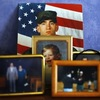 A portrait of Spc. Jonathan Nestico, 27, is displayed in his family's home in Woburn, Mass.