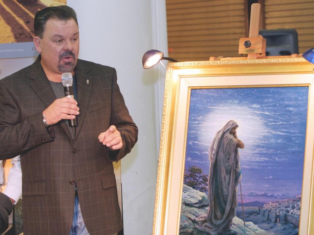 Artist Thomas Kinkade at the opening of an exhibit in Atlanta in 2006. Kinkade died Friday at his home in California at age 54.