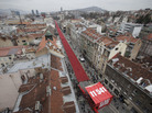 Red chairs fill a main street in Sarajevo on Friday as the city marks the 20th anniversary of the start of the Bosnian war. Officials lined up 11,541 chairs in 825 rows to represent the 11,541 Sarajevans who were killed during the siege.