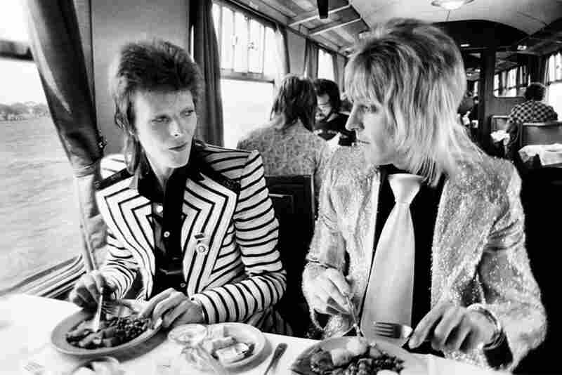 David Bowie and Mick Ronson at lunch on a train to Aberdeen, 1973
