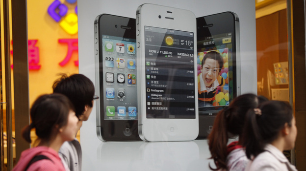 A report that a 17-year-old sold a kidney to buy an iPhone and an iPad has citizens worried about consumerism among China's youth. (AP)
