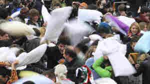 A pillow fight in London's Trafalgar Square in London, April 7, 2012.