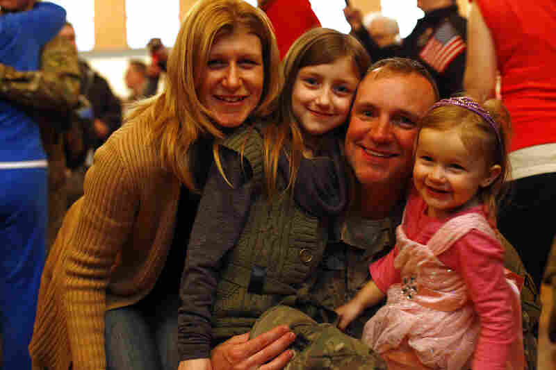 Michael Currie was stationed in Afghanistan for the past year, leaving behind his wife, Stacey, and daughters, Gracelyn and Isabella, 2.