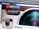 A photo illustration shows the photo-sharing app Instagram's  fan page on Facebook's website. Facebook is acquiring Instagram for some $1 billion.