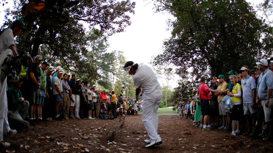 Bubba Watson hitting the hook that effectively won the Masters Tournament.