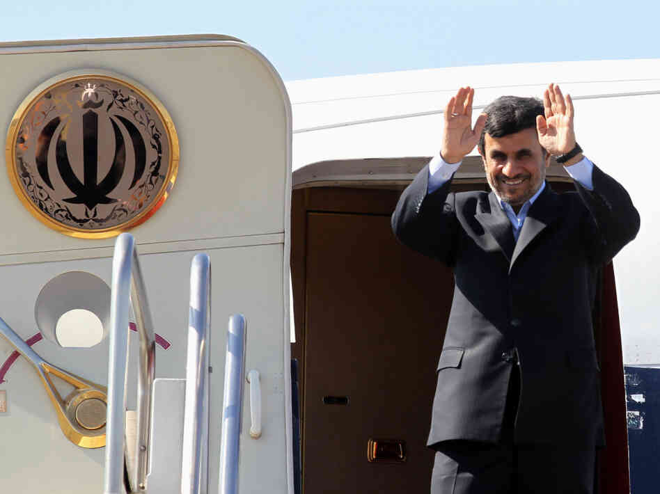 Iranian President Mahmoud Ahmadinejad waves prior to entering an airplane leaving Iran for Tajikistan at Tehran's Mehrabad airport on March 24, 2012. Ahmadinejad and his Afghan and Pakistani counterparts will meet in Tajikistan to mark Noruz (the Persian new year) and to discuss the Afghan economy.