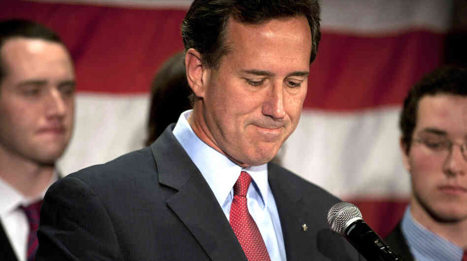 Rick Santorum announces he is suspending his campaign for president during a press conference in Gettysburg, Pa., on Tuesday, surrounded by family members.