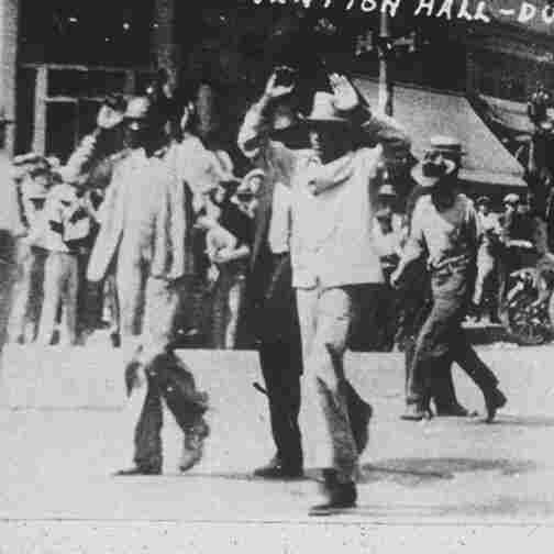 Black detainees are led to the Convention Hall following a race riot in Tulsa, Okla, June 1, 1921. The National Guard rounded up blacks by the thousands and took them to the fairgrounds, the Convention Hall and a baseball stadium where they were given food and water. By day's end, many thriving black businesses in a 35-block area had been torched.