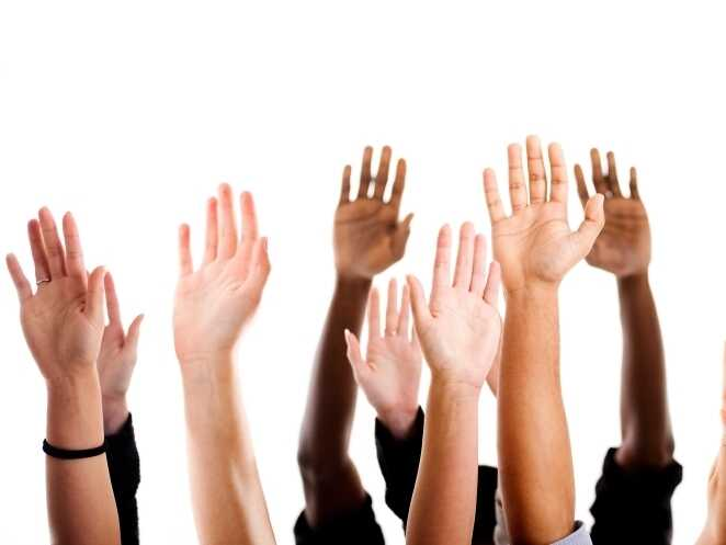Raised hands variety of races.
