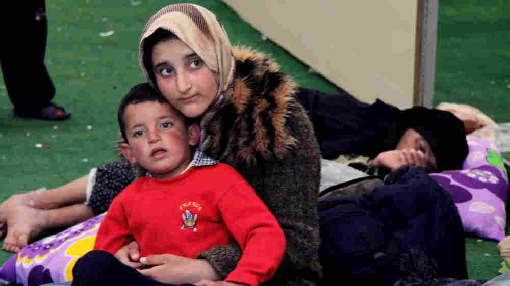 At a refugee camp in Reyhanli, Turkey, on Monday, Syrians sought help and safety.