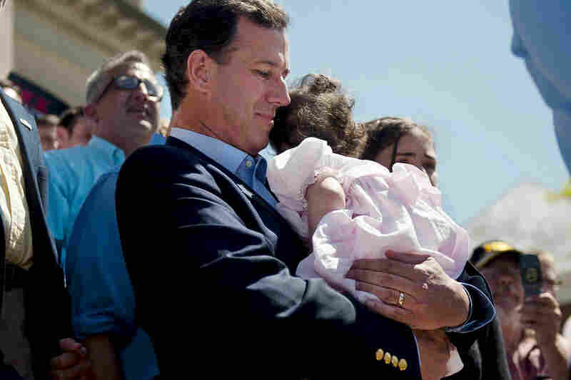 Santorum, shown holding his youngest child, Bella, who has a rare genetic disease, left the trail twice when she was hospitalized.