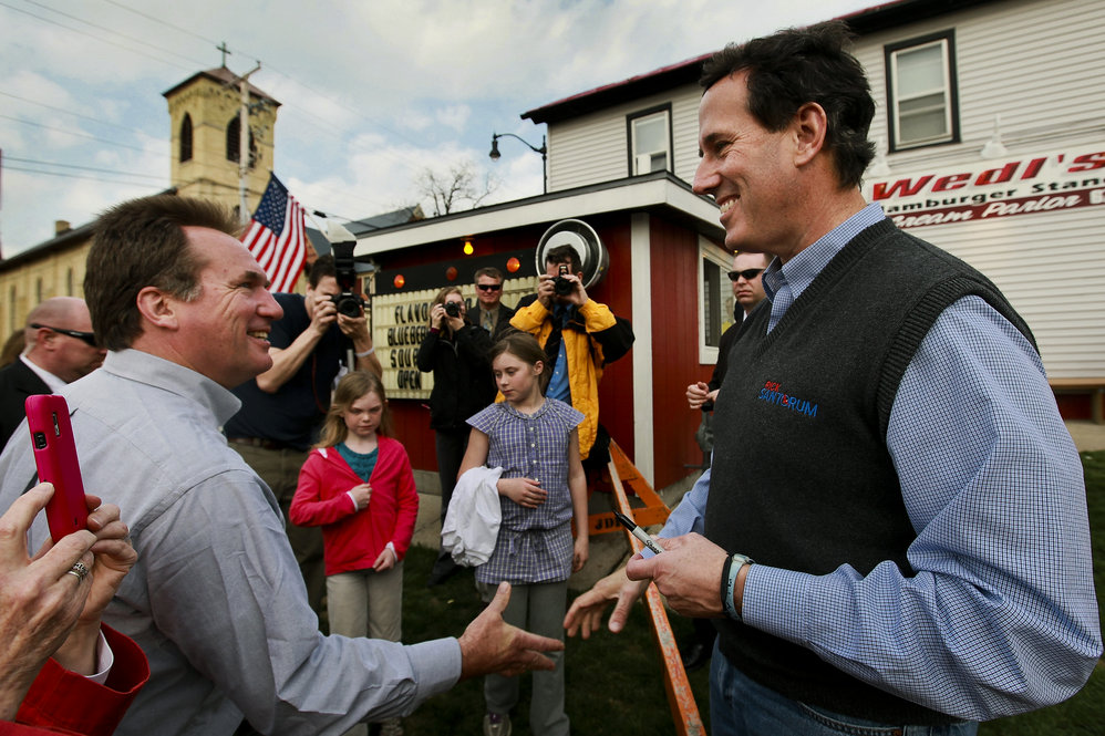 A week before Wisconsin's primary, Santorum chats with Mayor Dale Oppermann in Jefferson, Wis., on March 27.