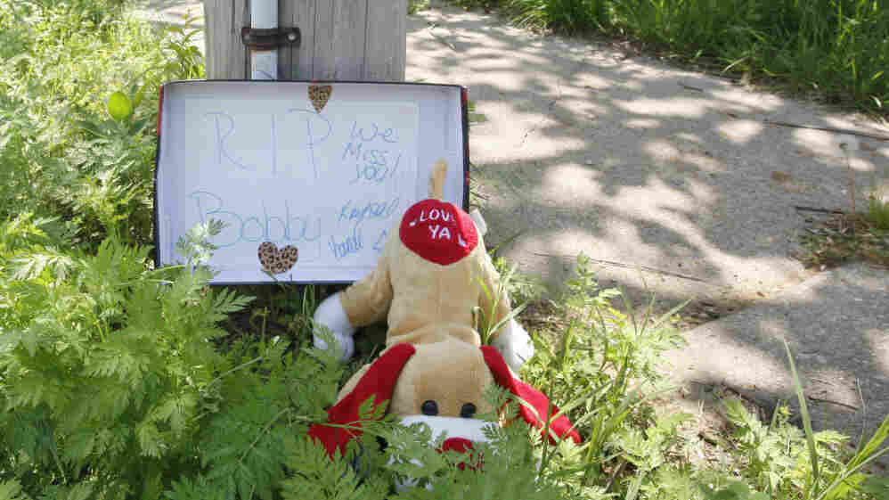 A makeshift memorial pays tribute to Bobby Clark, one of the victims of a shooting spree that left three people dead and terrorized Tulsa's African-American community.