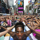 Bernice Acosta and other yoga enthusiasts practice in New York's Times Square at an event marking the 2011 summer solstice. Some Hindus say such events have little to do with yoga's spiritual roots.