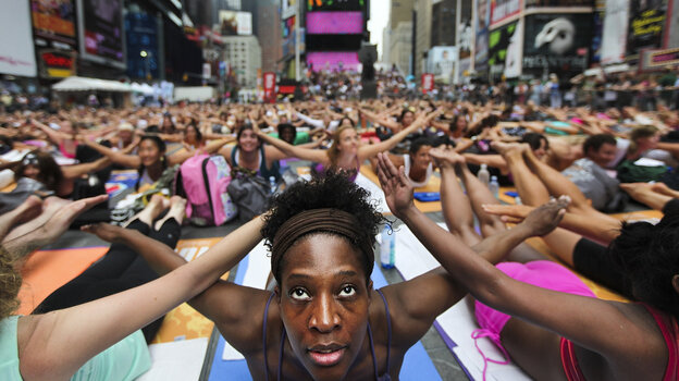 Bernice Acosta and other yoga enthusiasts practice in New York's Times Square at an event marking the 2011 summer solst