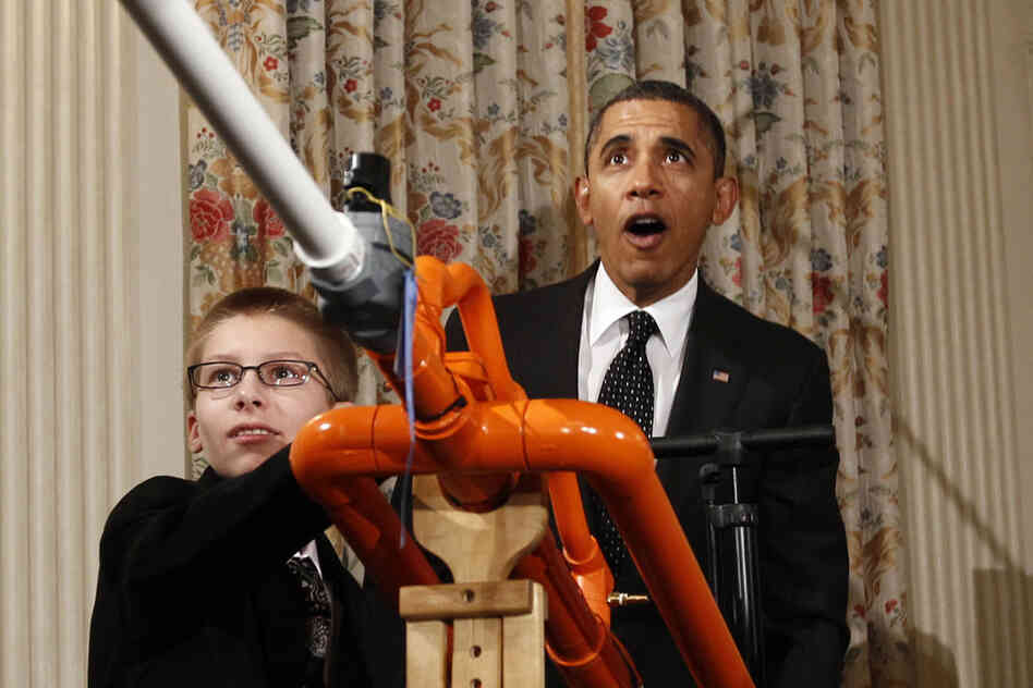 Blinded By Science: President Obama watches Joey Hudy fire his Extreme Marshmallow Cannon at the 2012 White House Science Fair.