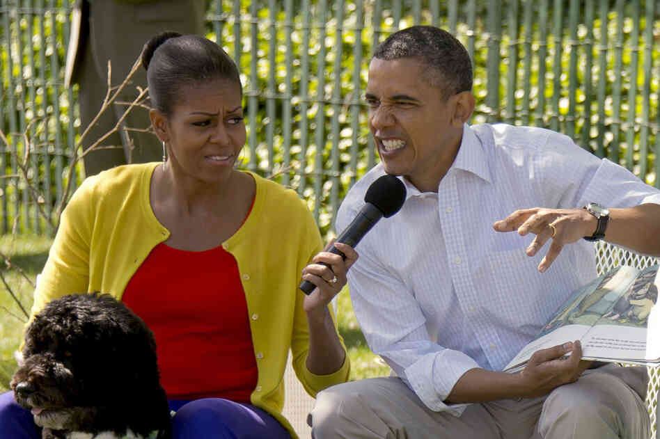 Wild Thing: Obama growls as he reads Where the Wild Things Are to children at this year's White House Easter Egg Roll.