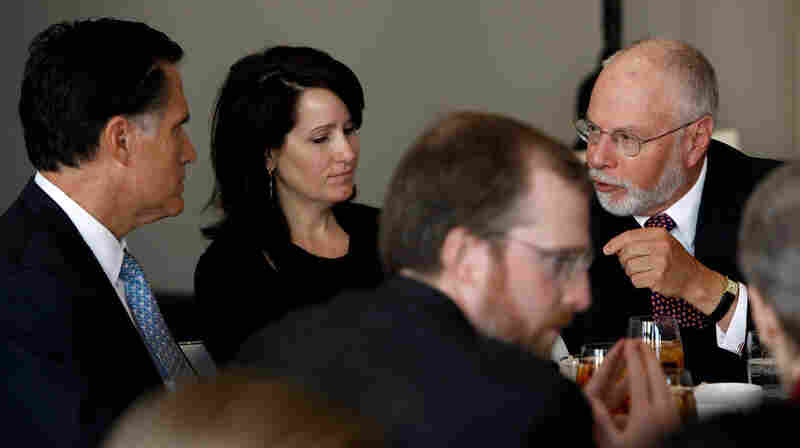 Paul Singer (right) speaks with Mitt Romney during a forum of the Foreign Policy Initiative in Washington in 2009.