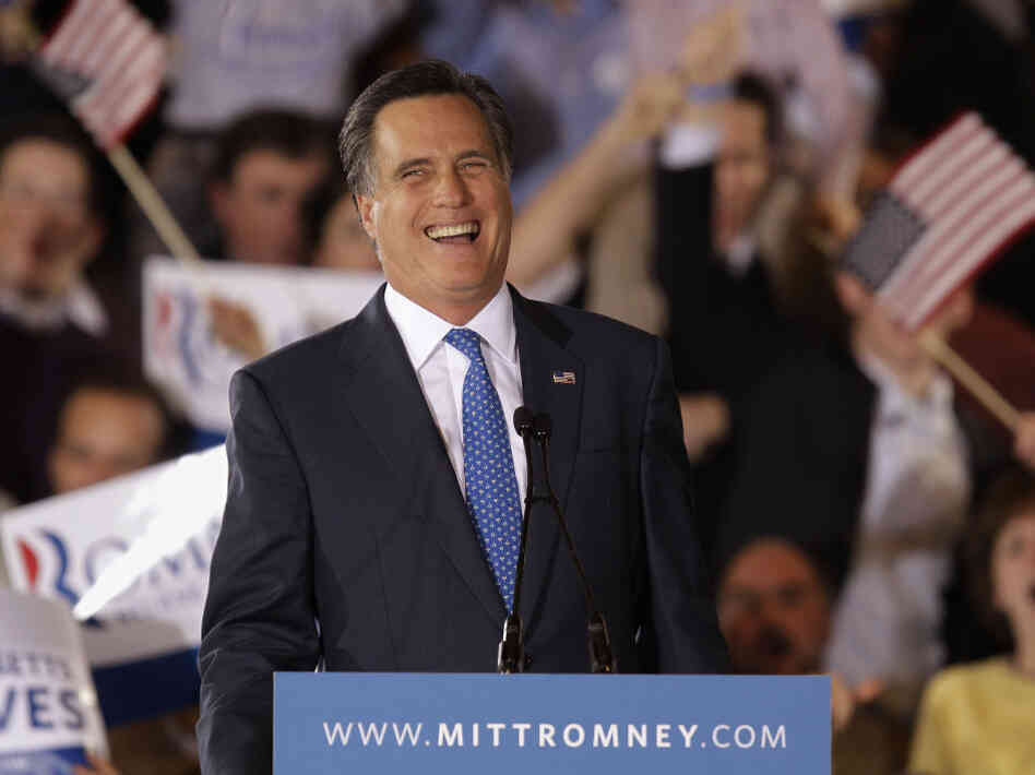Former Massachusetts Gov. Mitt Romney laughs while addressing supporters at his Super Tuesday campaign rally in Boston on March 6.