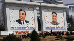 Mosaics of the two late North Korean leaders — Kim Jong Il (right) and Kim Il Sung, the country's founder — are unveiled Monday during celebrations marking the 100th anniversary of Kim Il Sung's birth, in Pyongyang, North Korea.