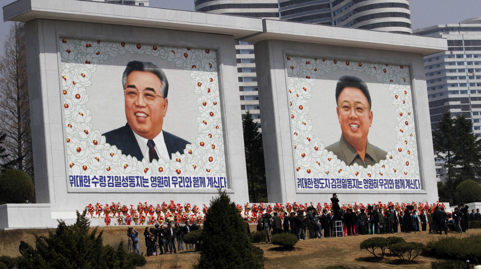 Mosaics of the two late North Korean leaders — Kim Jong Il (right) and Kim Il Sung, the country's founder — are unveiled Monday during celebrations marking the 100th anniversary of Kim Il Sung's birth, in Pyongyang, North Korea. (AP)